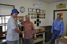 Denny Coulter, club President (R) presenting the William Coulter Standing Trophy to Morgan Diedrich (L)