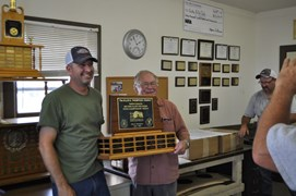Club President Denny Coulter (R) presenting the Ellise Thompson Trophy (600 yd High Score Shooter) to Russ Thuerer (L)