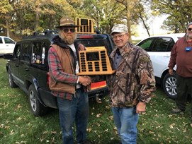 "Garald Gillies, winner of the F Class Open Category for shooting a 597 our of 600 with 36 ""X's"". Award presented by Cody Daglish."